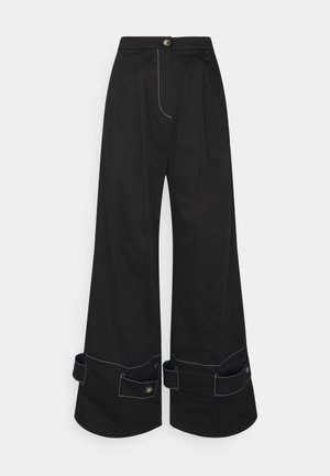 HOLLY - Trousers - black
