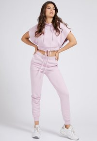 Guess - Tracksuit bottoms - rose - 1