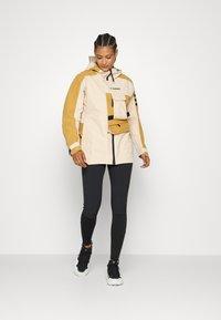 adidas Performance - TERREX XPLORIC RAIN - Hardshell jacket - halo blush/mesa - 5