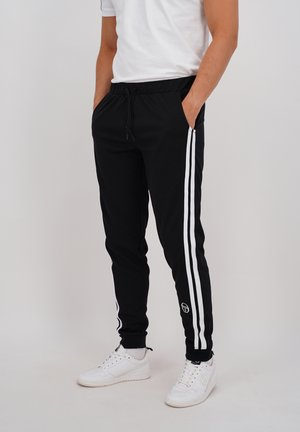STOFFHOSE NEW DAMARINDO PANTS ARCHIVIO - Tracksuit bottoms - blk/wht