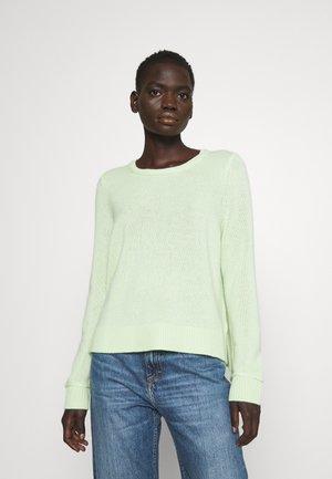 Stickad tröja - limelight