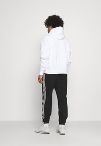 adidas Originals - NINJA PANT UNISEX - Träningsbyxor - black - 2