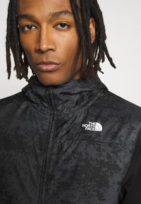 The North Face - TRAIN N LOGO OVERLAY JACKET - Veste légère - black / asphalt grey - 4
