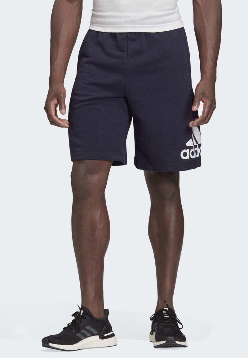 adidas Performance - MUST HAVES BADGE OF SPORT SHORTS - Short de sport - blue