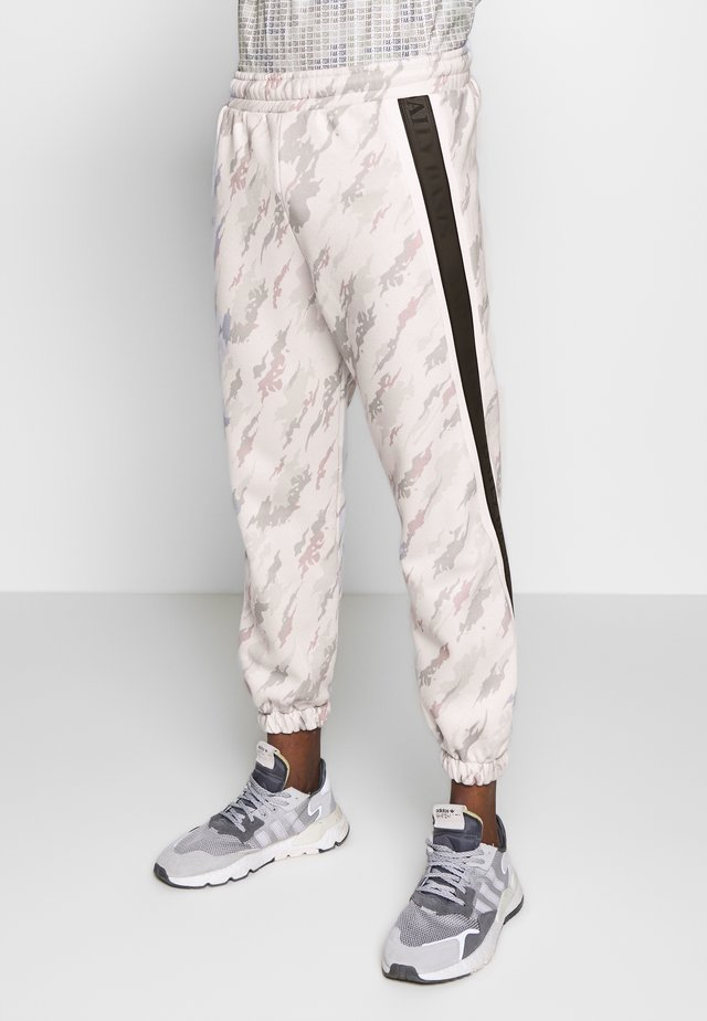 CAMO TAPED - Tracksuit bottoms - offwhite