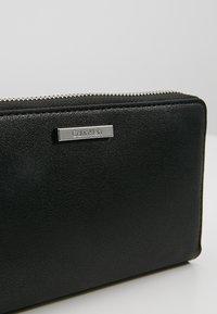 Calvin Klein - EXTENDED ZIPAROUND - Portefeuille - black - 2