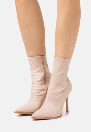 DIAMANTE STILETTO SOCK BOOT - Classic ankle boots - nude