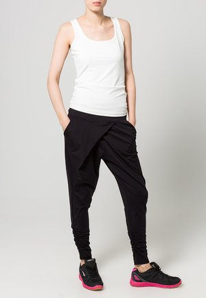 FLOW - Tracksuit bottoms - black