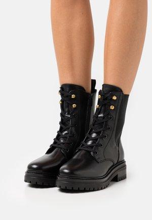 HINYA - Platform ankle boots - black