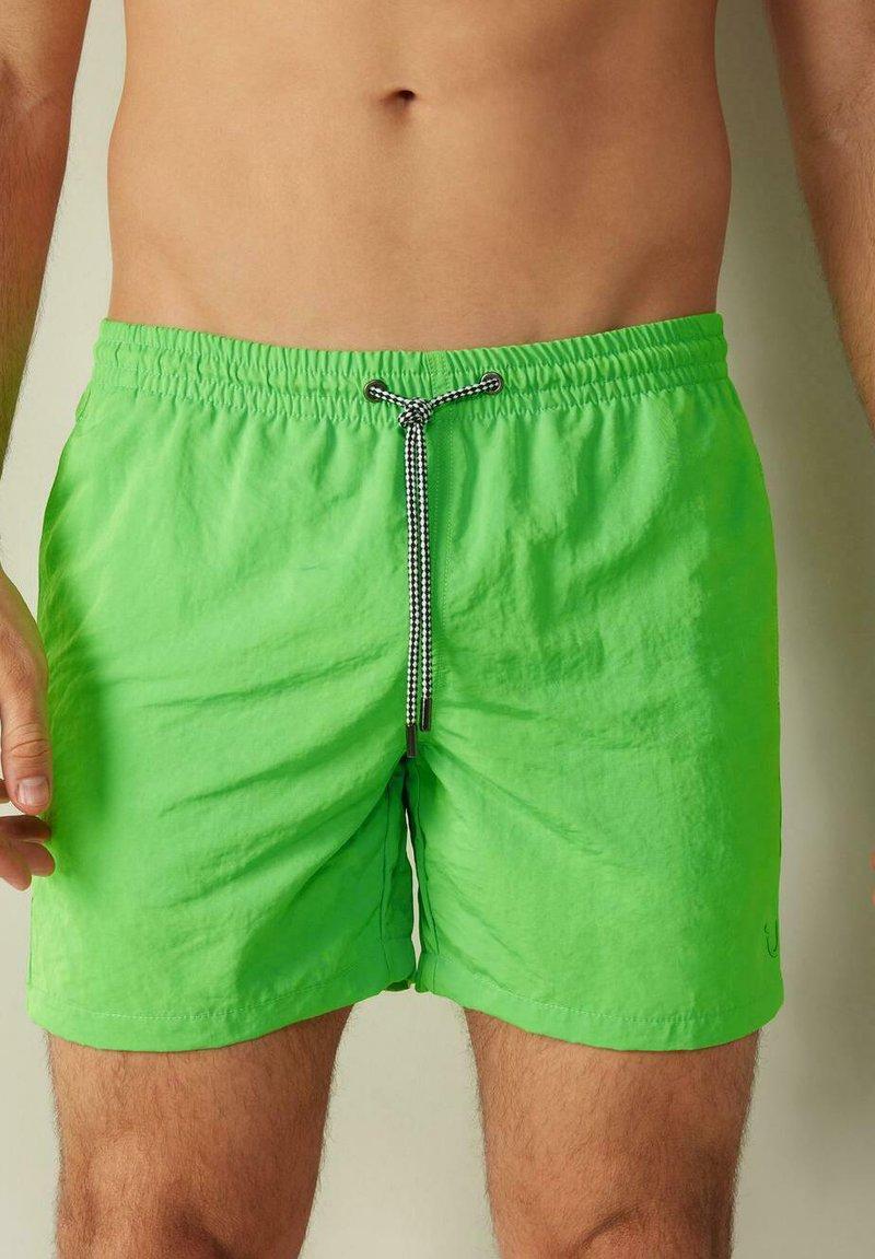Intimissimi - BOXER BADEHOSE - Swimming shorts - verde fluo