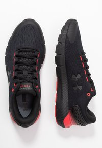 Under Armour - CHARGED  - Zapatillas de running neutras - black/versa red - 1