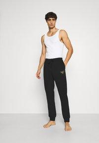 Emporio Armani - TROUSERS - Pantaloni del pigiama - nero - 1