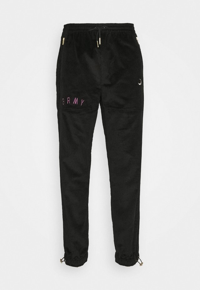 NITE MARAUDER TRACK PANTS UNISEX - Verryttelyhousut - black