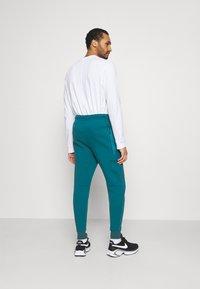 Nike Sportswear - TONE - Tracksuit bottoms - dark teal green/blustery - 2