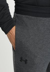 Under Armour - UNSTOPPABLE JOGGER - Tracksuit bottoms - black/black - 3