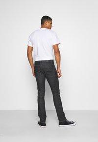 Nudie Jeans - GRIM TIM - Džíny Slim Fit - black pixel - 2