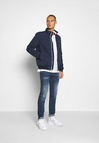 Tommy Jeans - ESSENTIAL PADDED JACKET - Veste mi-saison - twilight navy - 1