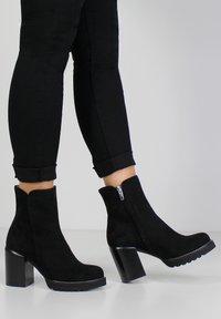 Evita - High heeled ankle boots - black - 0