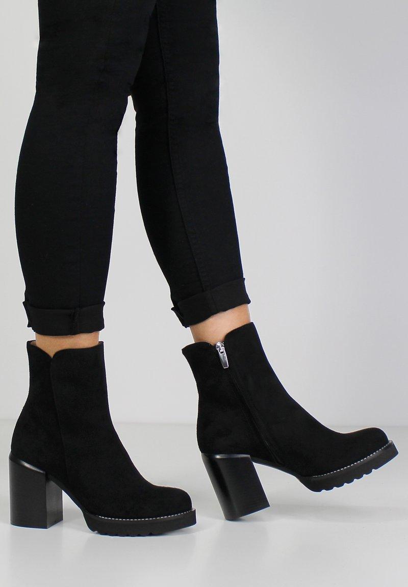 Evita - High heeled ankle boots - black