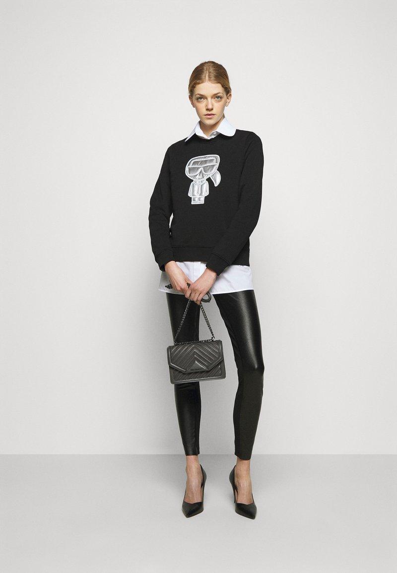 KARL LAGERFELD - METALLIC STRETCH - Leggings - Trousers - black