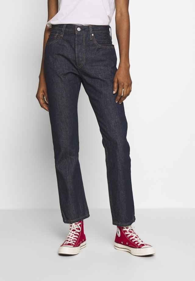 Jeans Straight Leg - across a plane