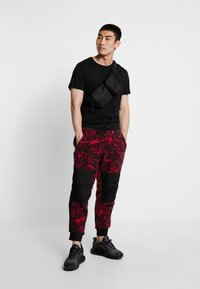The North Face - RAGE CLASSIC PANT - Spodnie treningowe - rose red - 1
