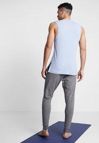 Nike Performance - M NK DRY PANT HPR DRY LT YOGA - Tracksuit bottoms - black - 2