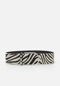 TUMBA - Waist belt - black/ white