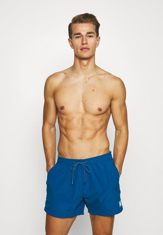 HESTER - Swimming shorts - blue