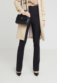 DKNY - WHITNEY SATCHEL - Across body bag - black/gold - 1