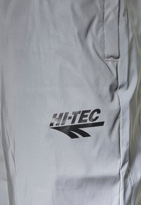 Hi-Tec - GRAHAM REFLECTIVE TRACK PANTS - Tracksuit bottoms - silver - 5