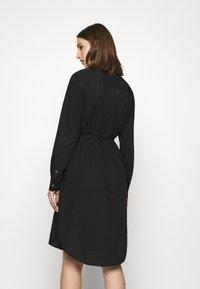 Calvin Klein - TIE CUFF SHIRT DRESS - Denní šaty - black - 2