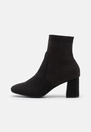 KEDEN - Classic ankle boots - black