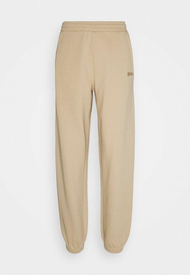 CREAM DOCTOR PANTS - Teplákové kalhoty - beige