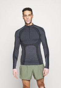 Endurance - KELULA SEAMLESS MIDLAYER - Long sleeved top - black - 0