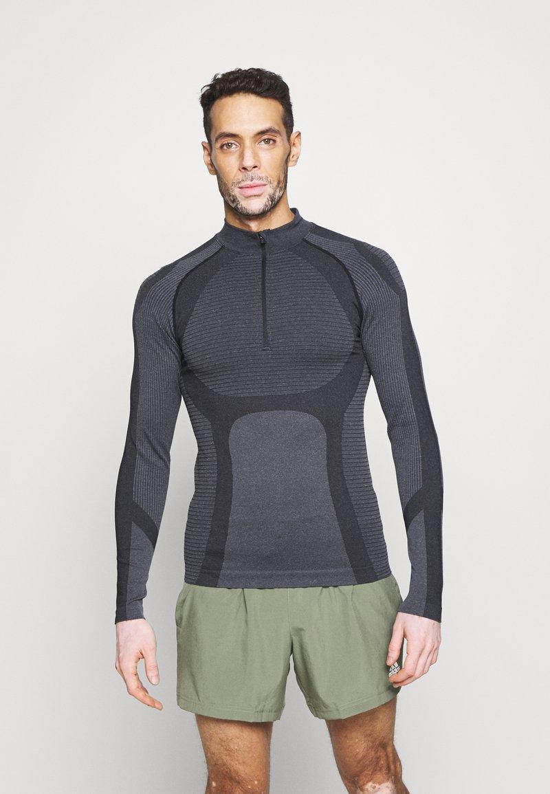 Endurance - KELULA SEAMLESS MIDLAYER - Long sleeved top - black