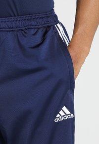 adidas Performance - TIRO - Spodnie treningowe - darkblue/white - 5