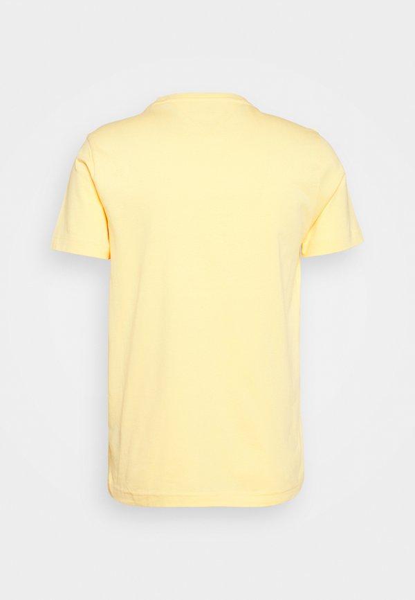 Tommy Hilfiger CIRCLE CHEST TEE - T-shirt z nadrukiem - delicate yellow/jasnożÓłty Odzież Męska QLMW