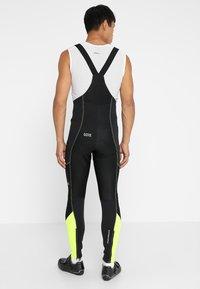Gore Wear - Punčochy - black/neon yellow - 2