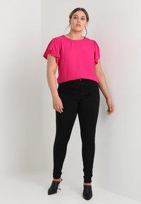 ONLY Carmakoma - CARSTORM - Jeans Skinny Fit - black - 1