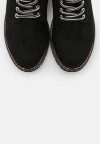 Jana - Lace-up ankle boots - black - 5