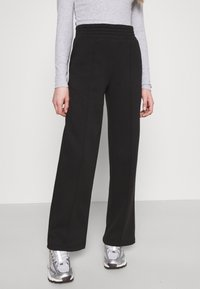 Pieces - PCCHILLI WIDE PANTS - Tracksuit bottoms - black - 3