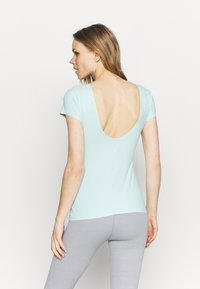 Nike Performance - THE YOGA LUXE - Basic T-shirt - teal tint/barely green - 2