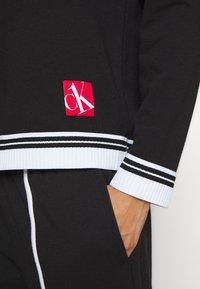 Calvin Klein Underwear - SOCK LOUNGE HOODIE - Pyjama top - black - 5