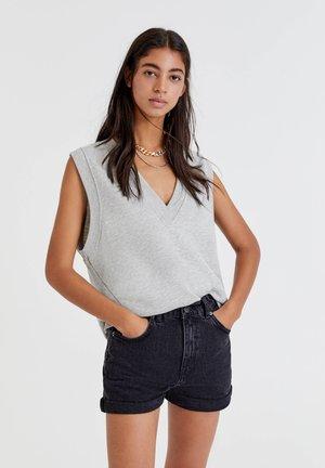 MIT GUMMIZÜGEN - Short en jean - black