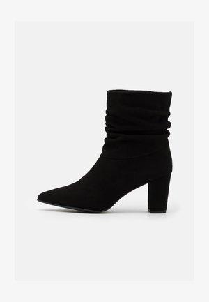 ANDREA - Korte laarzen - black
