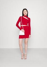 Milk it - MINI DRESS HIGH NECK CUTOUT CHEST - Shift dress - red - 1