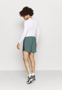 Nike Performance - Sports shorts - hasta/black - 2