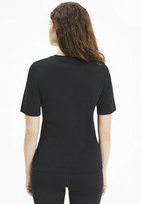 Puma - NU-TILITY - Print T-shirt - black - 2
