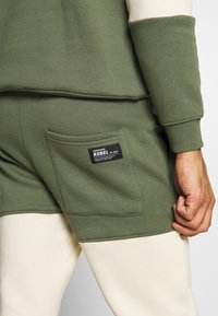 Redefined Rebel - DAWSON  - Tracksuit bottoms - thyme - 4